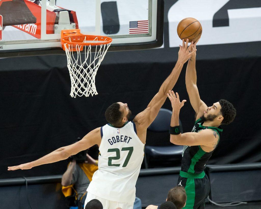 Feb 9, 2021; Salt Lake City, Utah, USA; Utah Jazz center Rudy Gobert (27) blocks the shot of Boston Celtics forward Jayson Tatum (0) during the second half at Vivint Smart Home Arena. Mandatory Credit: Russell Isabella-USA TODAY Sports
