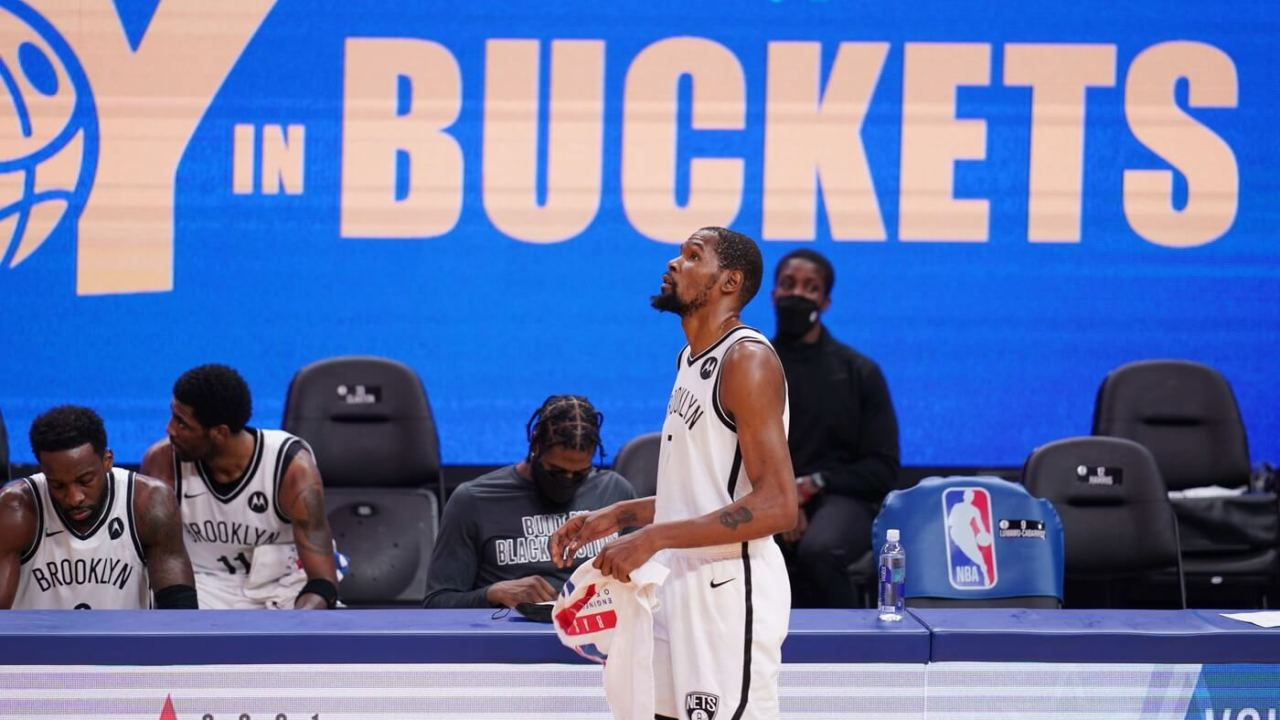 Brooklyn Nets forward Kevin Durant (7) walks in front of the team bench during a timeout against the Golden State Warriors in the fourth quarter at the Chase Center.