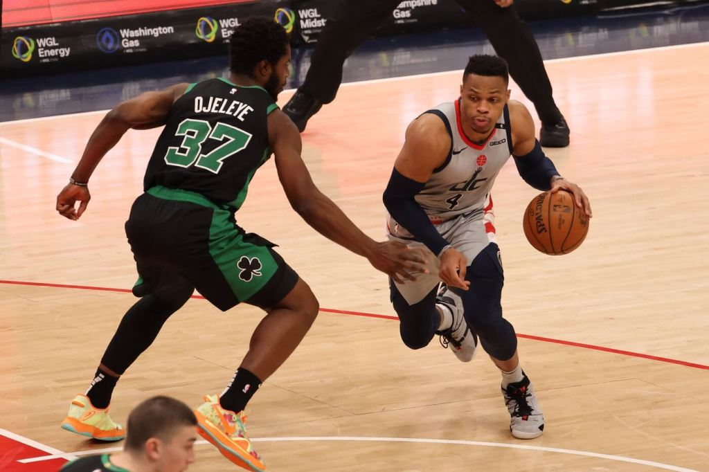 Feb 14, 2021; Washington, District of Columbia, USA; Washington Wizards guard Russell Westbrook (4) drives to the basket as Boston Celtics forward Semi Ojeleye (37) defends in the fourth quarter at Capital One Arena. Mandatory Credit: Geoff Burke-USA TODAY Sports