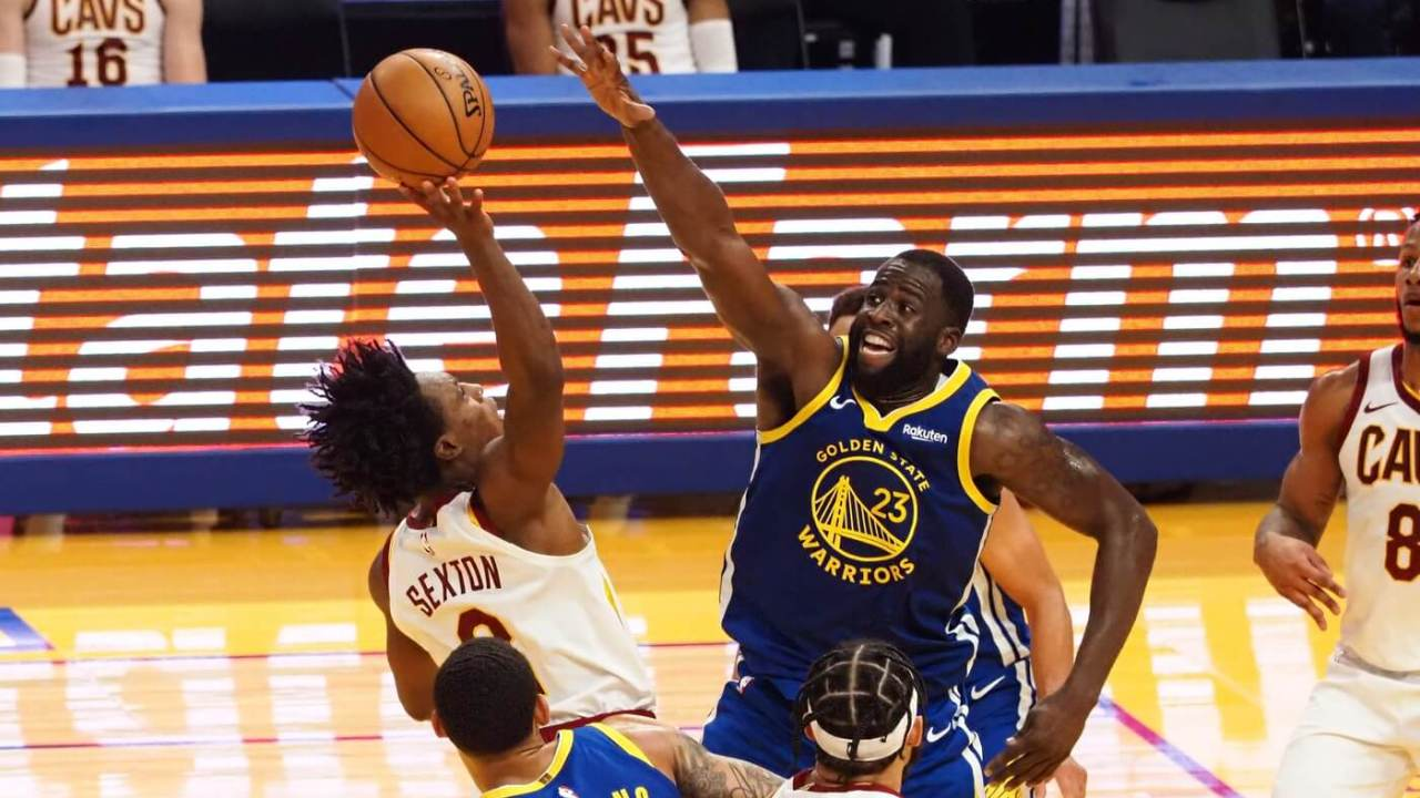 Feb 15, 2021; San Francisco, California, USA; Cleveland Cavaliers center JaVale McGee (6) shoot the ball against Golden State Warriors forward Draymond Green (23) during the third quarter at Chase Center. Mandatory Credit: Kelley L Cox-USA TODAY Sports