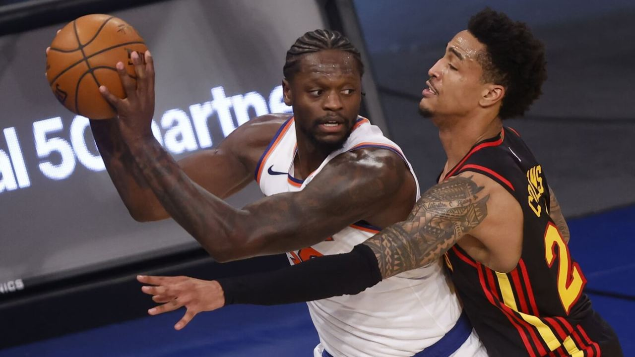 Caption: Feb 15, 2021; New York, New York, USA; New York Knicks' Julius Randle (30) protects the ball from Atlanta Hawks' John Collins (20) during the fourth quarter at Madison Square Garden.