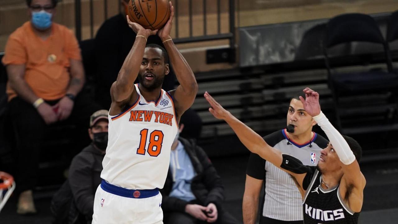 New York Knicks guard Alec Burks (18) shoots against Sacramento Kings guard Tyrese Haliburton (0) in the second half at Madison Square Garden.