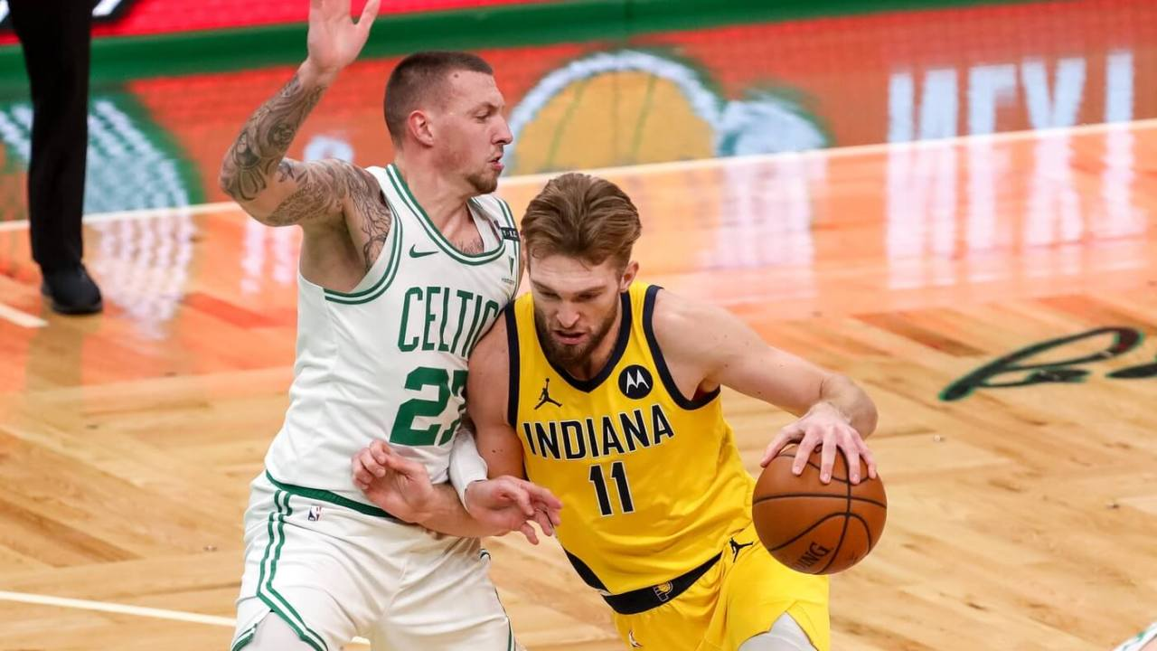 Indiana Pacers forward Domantas Sabonis (11) drives to the basket defended by Boston Celtics center Daniel Theis (27) at TD Garden.