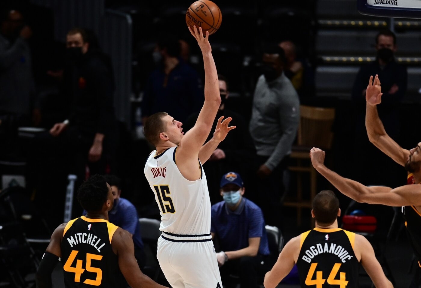 Jan 31, 2021; Denver, Colorado, USA; Denver Nuggets center Nikola Jokic (15) shoots the ball in the first quarter against the Utah Jazz at Ball Arena. Mandatory Credit: Ron Chenoy-USA TODAY Sports