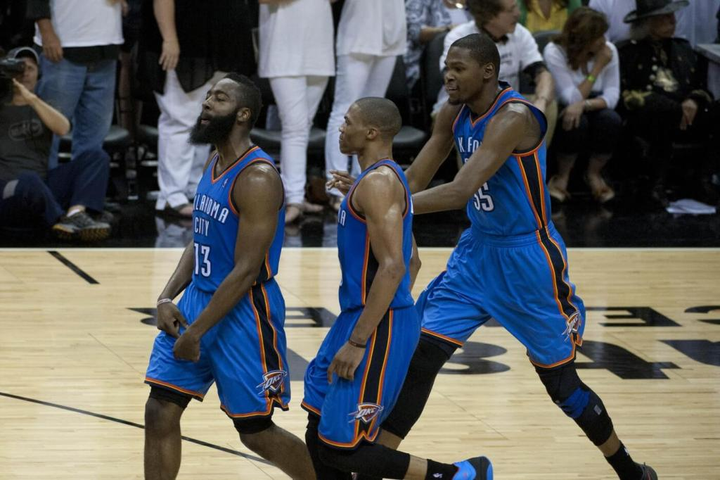 June 4, 2012; San Antonio, TX, USA; Oklahoma City Thunder guards James Harden (13) and Russell Westbrook (center) and forward Kevin Durant (35) react against the San Antonio Spurs during the second half in game five of the Western Conference finals of the 2012 NBA playoffs at the AT&T Center. Oklahoma City beat San Antonio 108-106. Mandatory Credit: Brendan Maloney-USA TODAY Sports