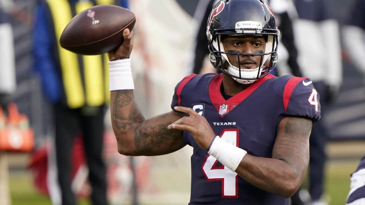 Dec 13, 2020; Chicago, Illinois, USA; Houston Texans quarterback Deshaun Watson (4) throws a pass against the Chicago Bears during the fourth quarter at Soldier Field. Mandatory Credit: Mike Dinovo-USA TODAY Sports