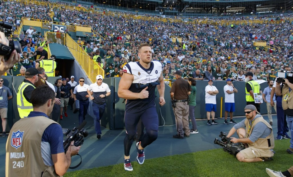 Aug 8, 2019; Green Bay, WI, USA; Houston Texans defensive end J.J. Watt (99) runs onto the field prior to the game against the Green Bay Packers at Lambeau Field. Mandatory Credit: Jeff Hanisch-USA TODAY Sports