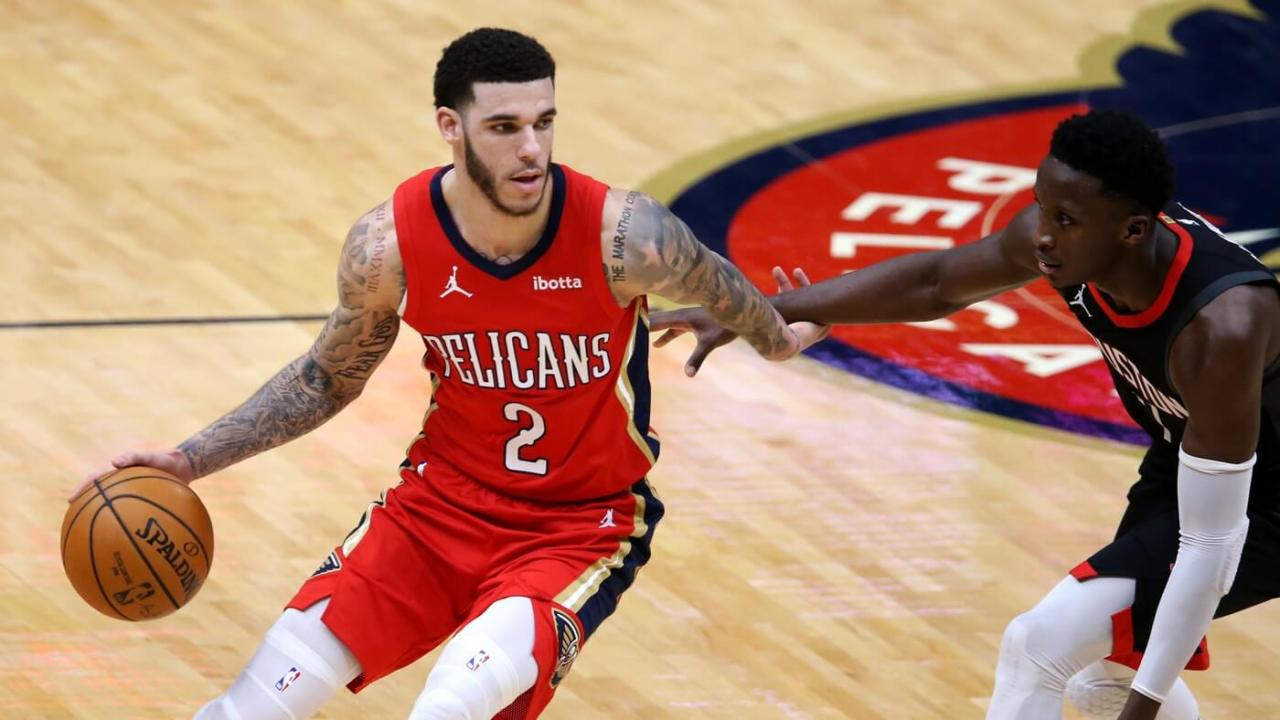 Jan 30, 2021; New Orleans, Louisiana, USA; New Orleans Pelicans guard Lonzo Ball (2) dribbles around Houston Rockets guard Victor Oladipo (7) in the third quarter at the Smoothie King Center. Mandatory Credit: Chuck Cook-USA TODAY Sports