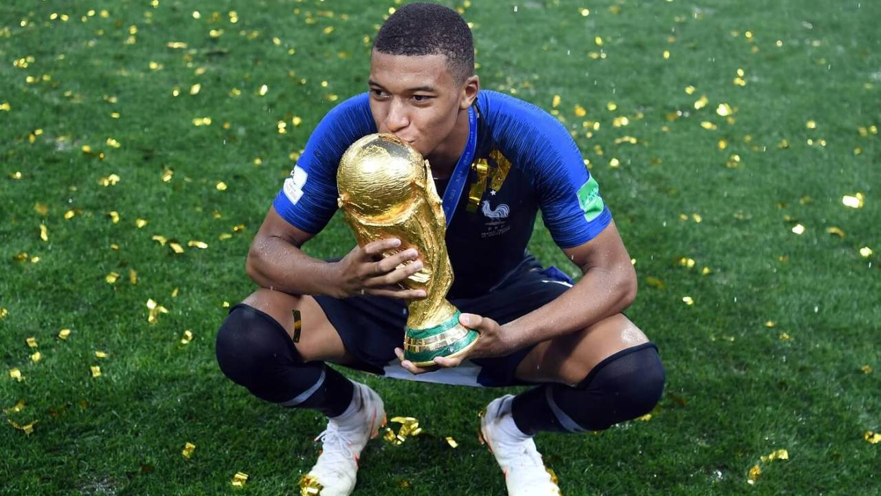 July 15, 2018; Moscow, Russia; France forward Kylian Mbappe celebrates with the trophy after defeating Croatia in the final of the FIFA World Cup 2018 at Luzhniki Stadium. Mandatory Credit: Tim Groothuis/Witters Sport via USA TODAY Sports
