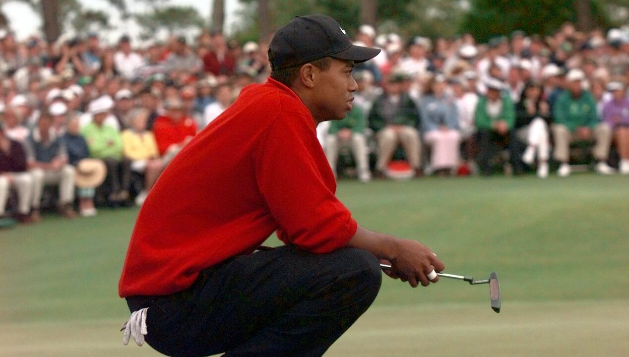 April 13, 1997; Augusta, GA, USA; Tiger Woods waits his turn at the 18th hole before winning the 1997 Masters. Mandatory Credit: Porter Binks/USA TODAY