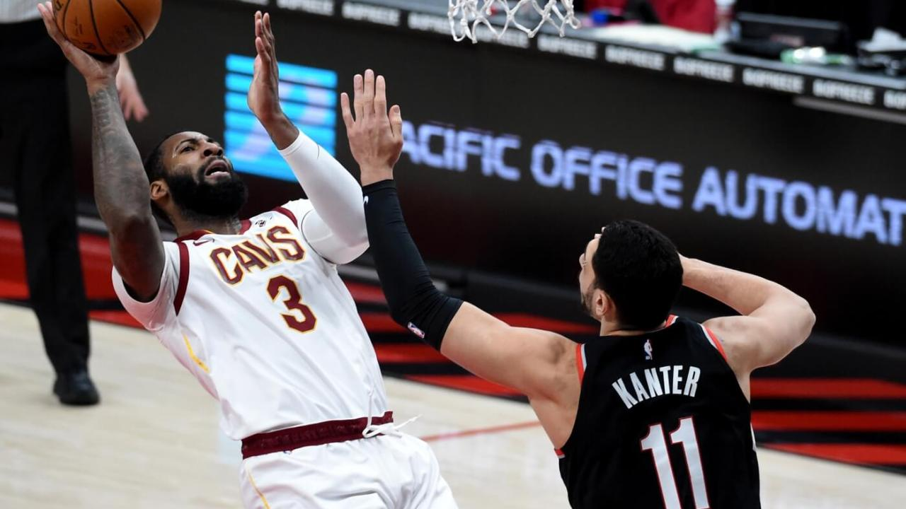 Feb 12, 2021; Portland, Oregon, USA; Cleveland Cavaliers center Andre Drummond (3) shoots the ball over Portland Trail Blazers center Enes Kanter (11) during the first half at Moda Center. Mandatory Credit: Steve Dykes-USA TODAY Sports