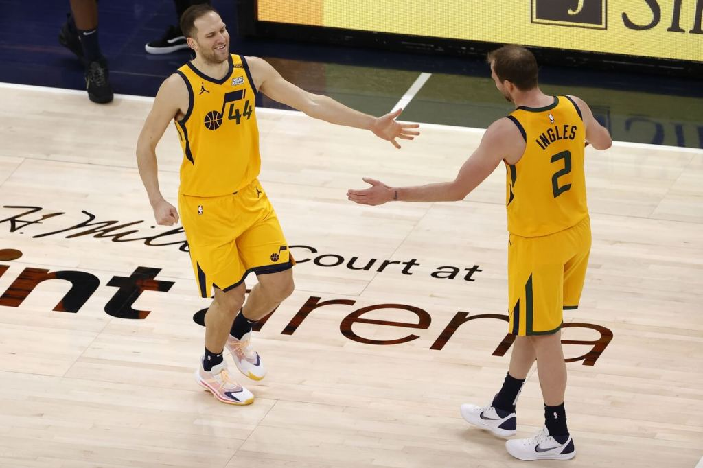 Feb 2, 2021; Salt Lake City, Utah, USA; Utah Jazz forward Bojan Bogdanovic (44) reacts after a three point shot with forward Joe Ingles (2) in the first quarter at Vivint Smart Home Arena. Mandatory Credit: Jeffrey Swinger-USA TODAY Sports