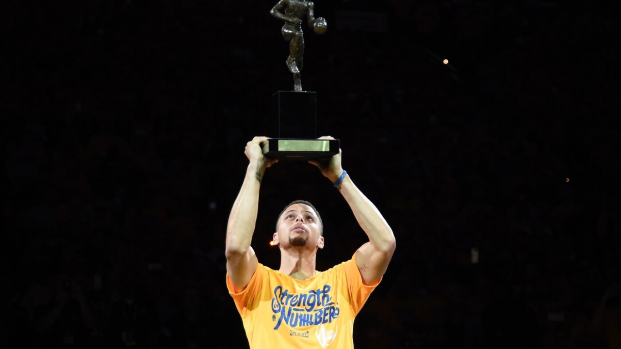 May 11, 2016; Oakland, CA, USA; Golden State Warriors guard Stephen Curry (30) hoists the MVP trophy before game five of the second round of the NBA Playoffs against the Portland Trail Blazers at Oracle Arena. Mandatory Credit: Kyle Terada-USA TODAY Sports