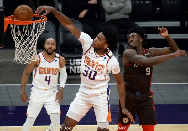 Feb 22, 2021; Phoenix, Arizona, USA; Phoenix Suns center Damian Jones (30) dunks over Portland Trail Blazers forward Nassir Little (9) during the second half at Phoenix Suns Arena. Mandatory Credit: Joe Camporeale-USA TODAY Sports