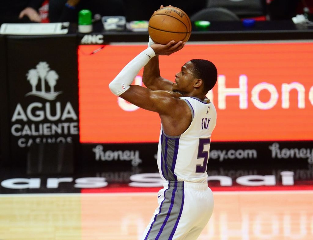 Feb 7, 2021; Los Angeles, California, USA; Sacramento Kings guard De'Aaron Fox (5) shoot against the Los Angeles Clippers during the second half at Staples Center. Mandatory Credit: Gary A. Vasquez-USA TODAY Sports