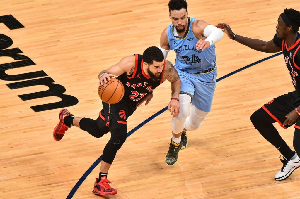 Feb 8, 2021; Memphis, Tennessee, USA; Toronto Raptors guard Fred VanVleet (23) goes to the basket against Memphis Grizzlies guard Dillon Brooks (24) during the second half at FedExForum. Mandatory Credit: Justin Ford-USA TODAY Sports