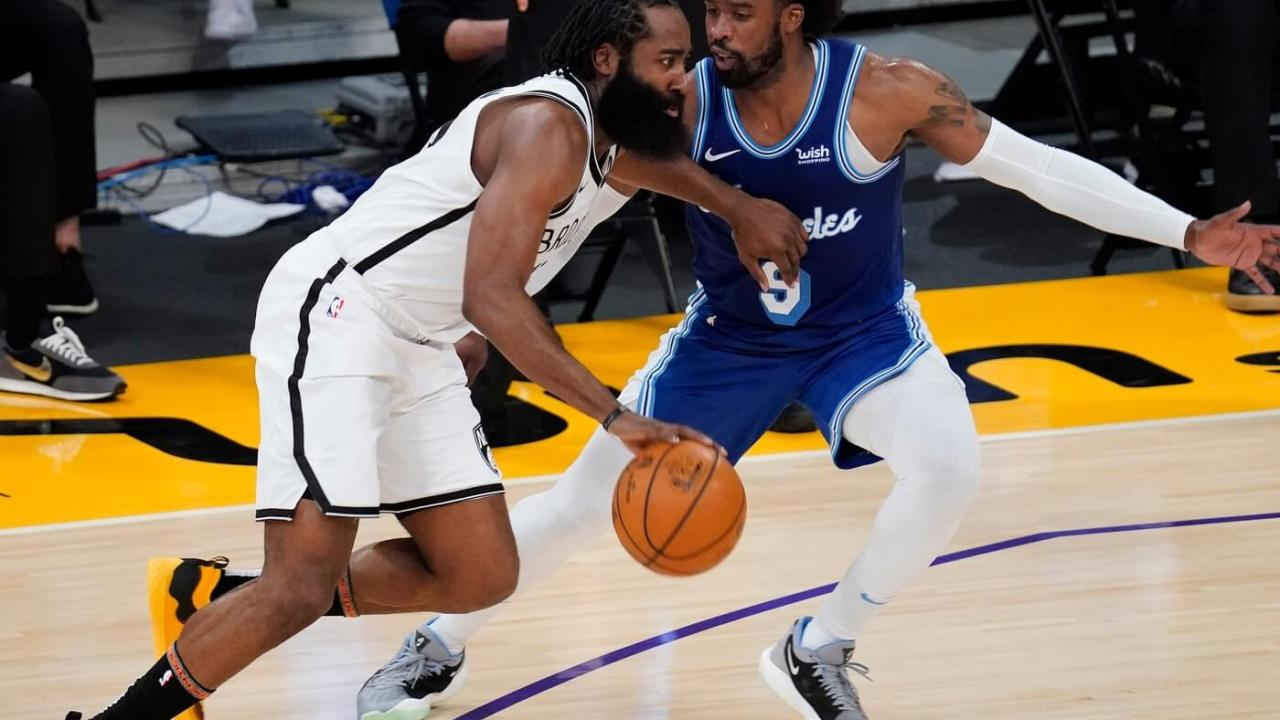 Feb 18, 2021; Los Angeles, California, USA; Brooklyn Nets guard James Harden (13) drives to the basket defended by Los Angeles Lakers guard Wesley Matthews (9) during the second half at Staples Center. Mandatory Credit: Robert Hanashiro-USA TODAY Sports
