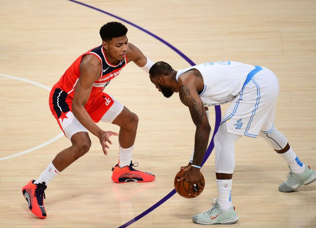 Feb 22, 2021; Los Angeles, California, USA; Washington Wizards forward Rui Hachimura (8) defends against Los Angeles Lakers forward LeBron James (23) during the first half at Staples Center. Mandatory Credit: Gary A. Vasquez-USA TODAY Sports