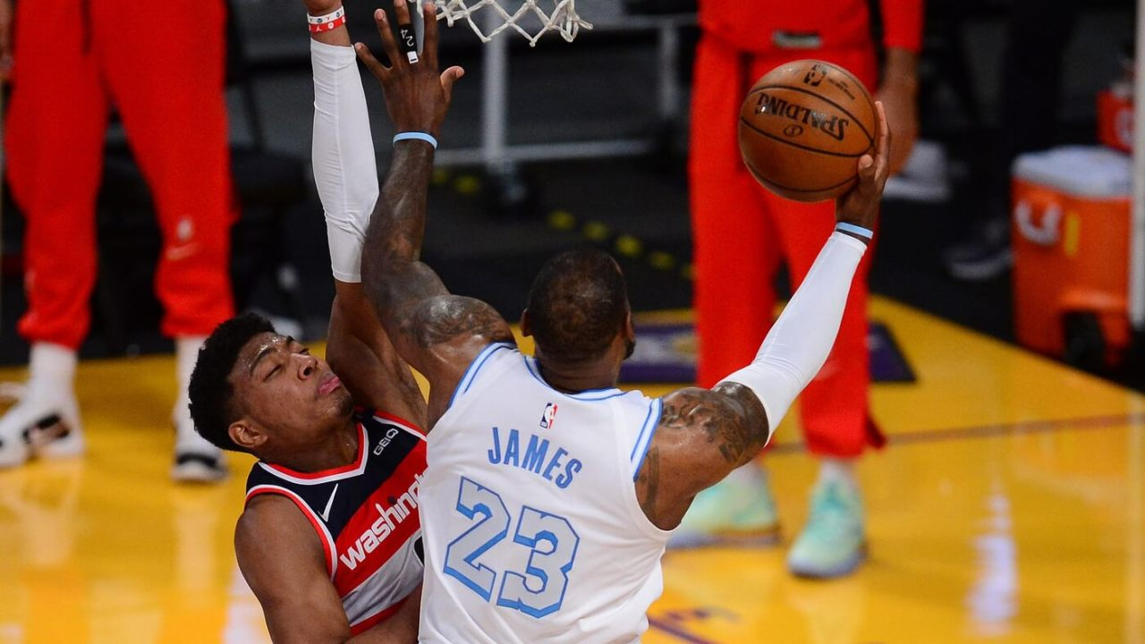 Feb 22, 2021; Los Angeles, California, USA; Los Angeles Lakers forward LeBron James (23) moves to the basket against Washington Wizards forward Rui Hachimura (8) during overtime at Staples Center. Mandatory Credit: Gary A. Vasquez-USA TODAY Sports