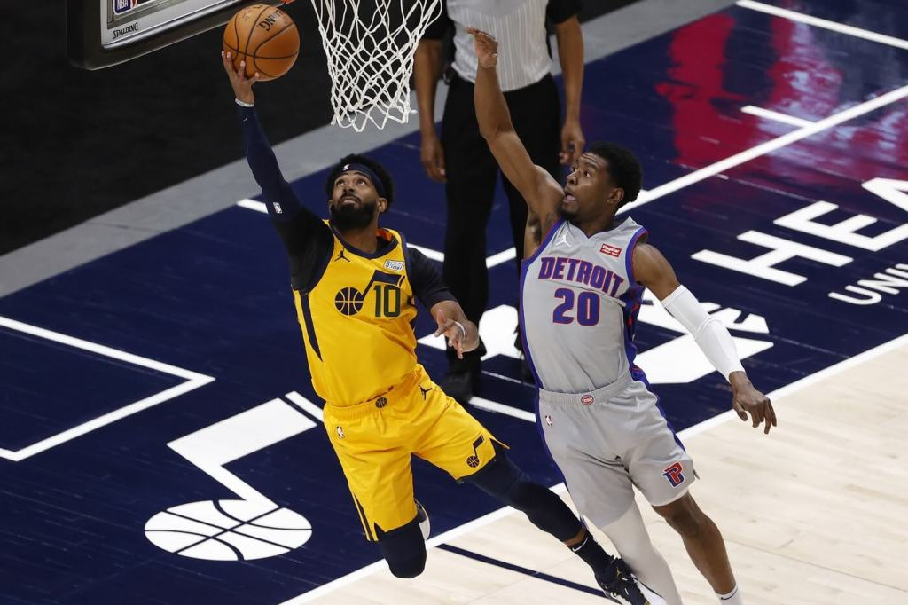 Feb 2, 2021; Salt Lake City, Utah, USA; Utah Jazz guard Mike Conley (10) drives to the hoop against Detroit Pistons guard Josh Jackson (20) in the first quarter at Vivint Smart Home Arena. Mandatory Credit: Jeffrey Swinger-USA TODAY Sports