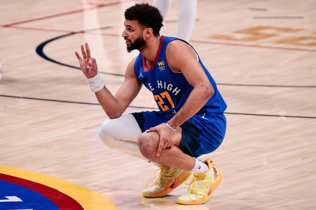 Feb 8, 2021; Denver, Colorado, USA; Denver Nuggets guard Jamal Murray (27) reacts in the second quarter against the Milwaukee Bucks at Ball Arena. Mandatory Credit: Isaiah J. Downing-USA TODAY Sports