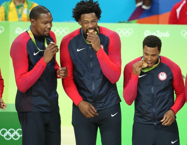 Aug 21, 2016; Rio de Janeiro, Brazil; United States forward Kevin Durant (5) United States center DeAndre Jordan (6) and United States guard Kyle Lowry (7) celebrate winning the gold medal in the men's basketball event during the Rio 2016 Summer Olympic Games at Carioca Arena 1. Mandatory Credit: Jason Getz-USA TODAY Sports