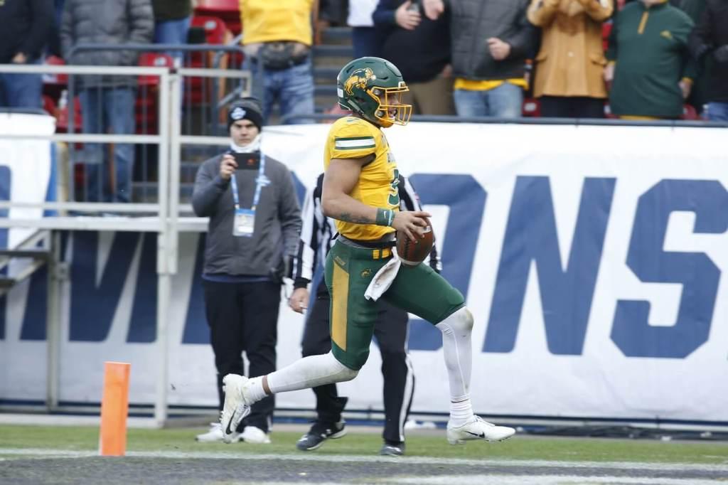 Jan 11, 2020; Frisco, Texas, USA; North Dakota State Bison quarterback Trey Lance (5) scores a touchdown in the fourth quarter against the James Madison Dukes at Toyota Stadium. Mandatory Credit: Tim Heitman-USA TODAY Sports