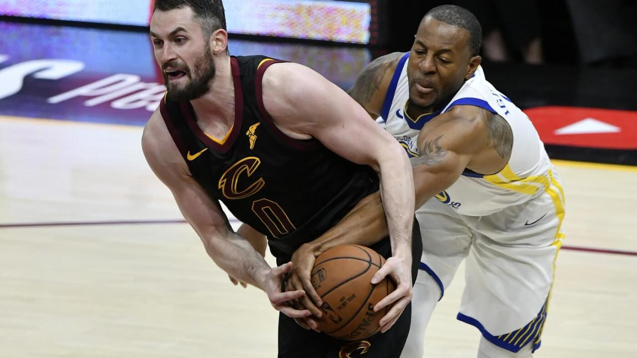 Jun 6, 2018; Cleveland, OH, USA; Cleveland Cavaliers center Kevin Love (0) tries to drive against Golden State Warriors forward Andre Iguodala (right) during the fourth quarter in game three of the 2018 NBA Finals at Quicken Loans Arena. Mandatory Credit: David Richard-USA TODAY Sports