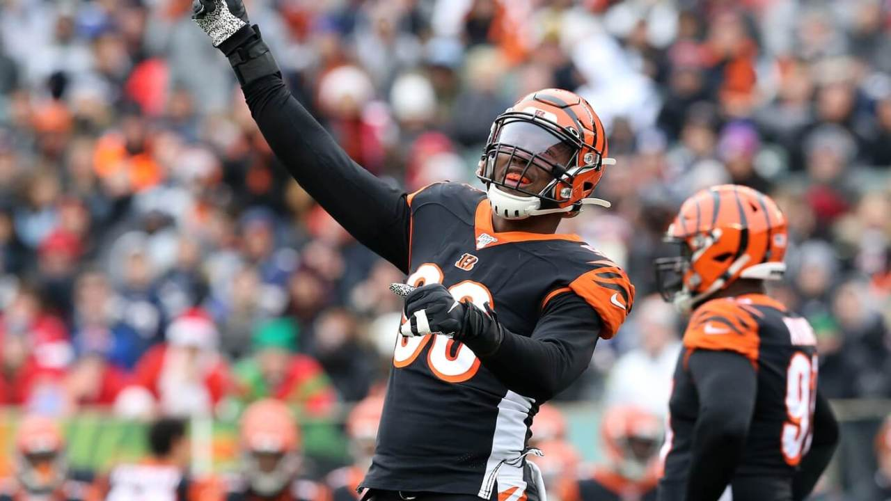 Cincinnati Bengals defensive end Carlos Dunlap (96) pumps up the crowd during the second quarter of an NFL Week 15 game against the New England Patriots, Sunday, Dec. 15, 2019, at Paul Brown Stadium in Cincinnati.