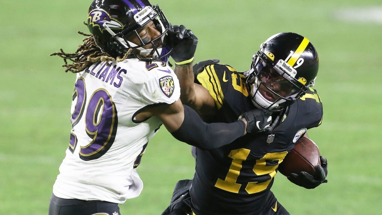 Pittsburgh Steelers wide receiver JuJu Smith-Schuster (19) runs after a catch against Baltimore Ravens cornerback Tramon Williams (29) during the fourth quarter at Heinz Field. Pittsburgh won 19-14.