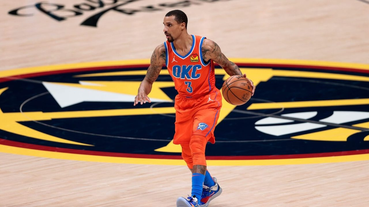 Oklahoma City Thunder guard George Hill (3) dribbles the ball up court against the Denver Nuggets in the third quarter at Ball Arena.