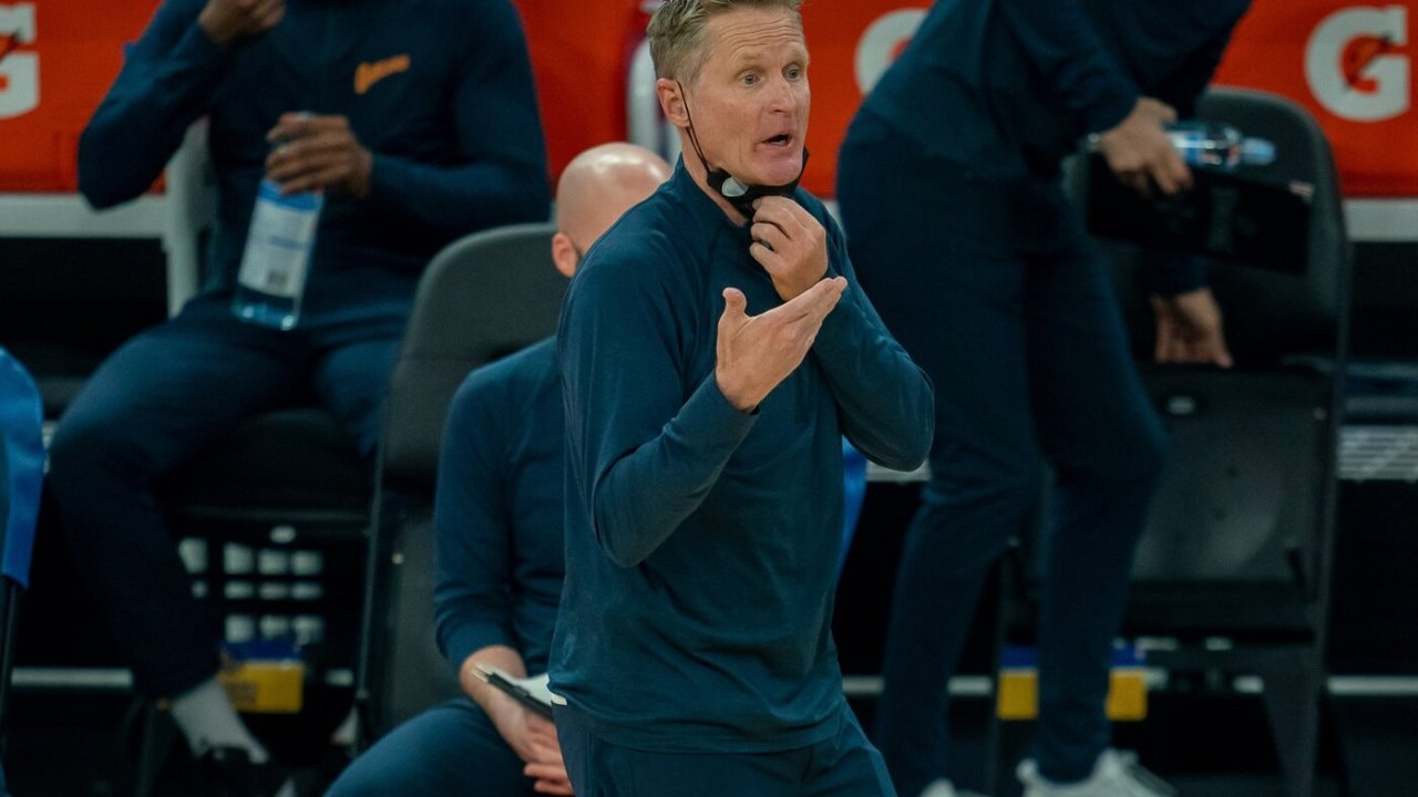 Golden State Warriors head coach Steve Kerr instructs players from the sidelines against the Miami Heat during the first quarter at Chase Center.