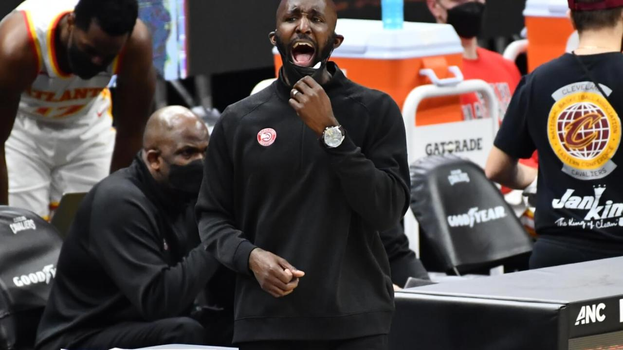 Atlanta Hawks head coach Lloyd Pierce yells to his team during the third quarter against the Cleveland Cavaliers at Rocket Mortgage FieldHouse.
