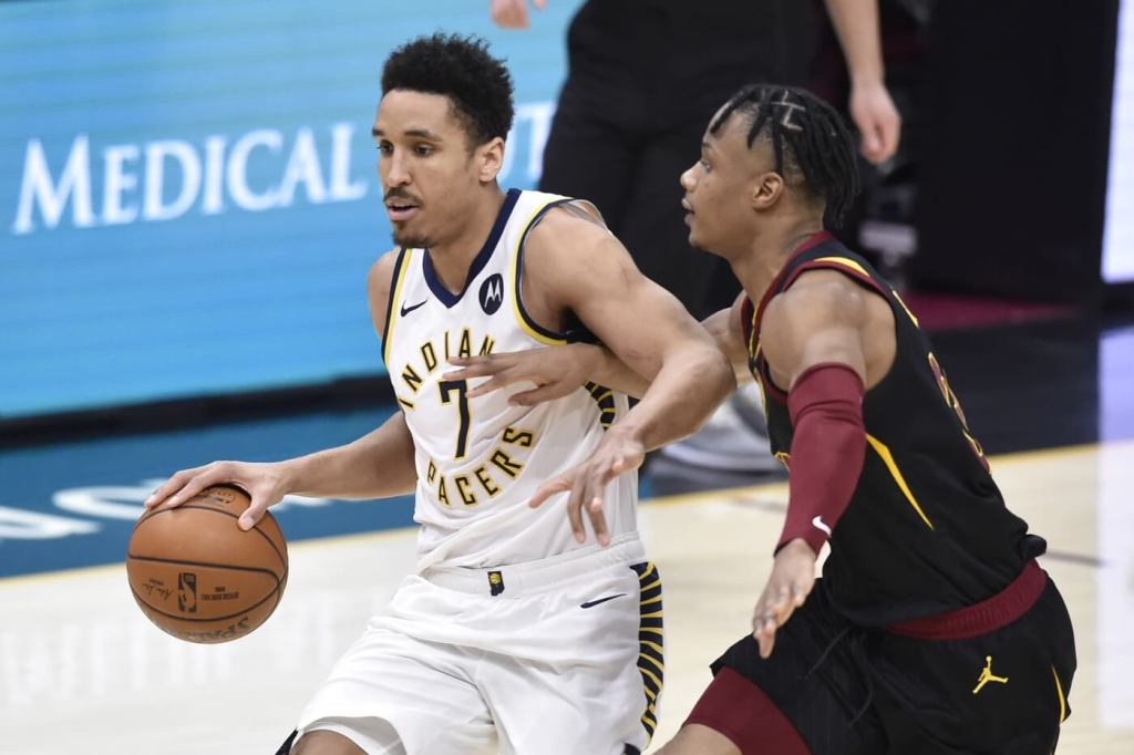 Indiana Pacers guard Malcolm Brogdon (7) drives against Cleveland Cavaliers guard Isaac Okoro (35) in the fourth quarter at Rocket Mortgage FieldHouse.
