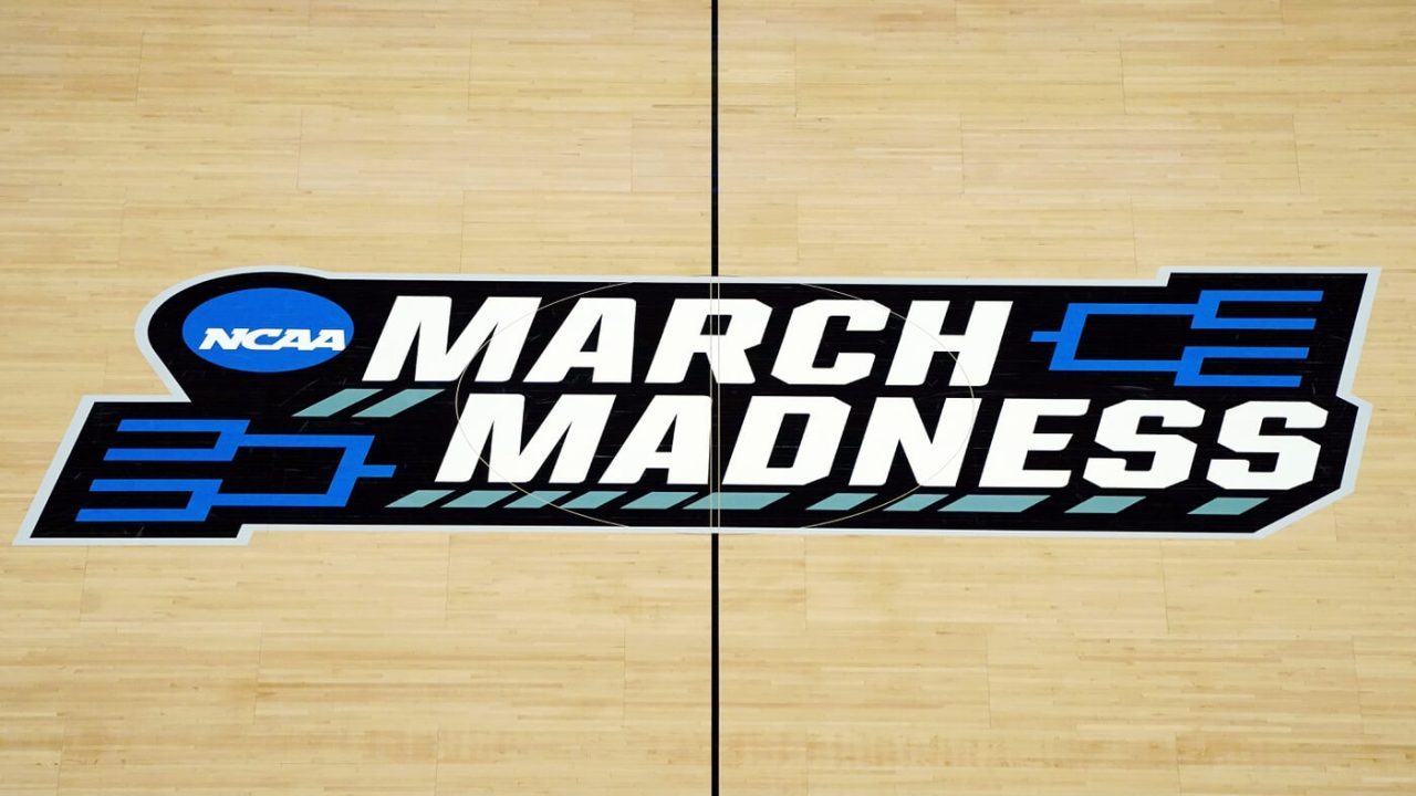 Mar 21, 2021; Indianapolis, Indiana, USA; The March Madness logo in center court before the game between the Loyola Ramblers and the Illinois Fighting Illini in the second round of the 2021 NCAA Tournament at Bankers Life Fieldhouse.