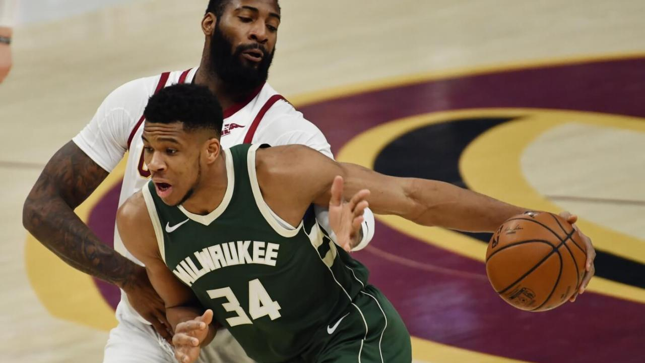 Feb 6, 2021; Cleveland, Ohio, USA; Cleveland Cavaliers center Andre Drummond (3) tries to strip the ball from Milwaukee Bucks forward Giannis Antetokounmpo (34) during the first quarter at Rocket Mortgage FieldHouse. Mandatory Credit: Ken Blaze-USA TODAY Sports