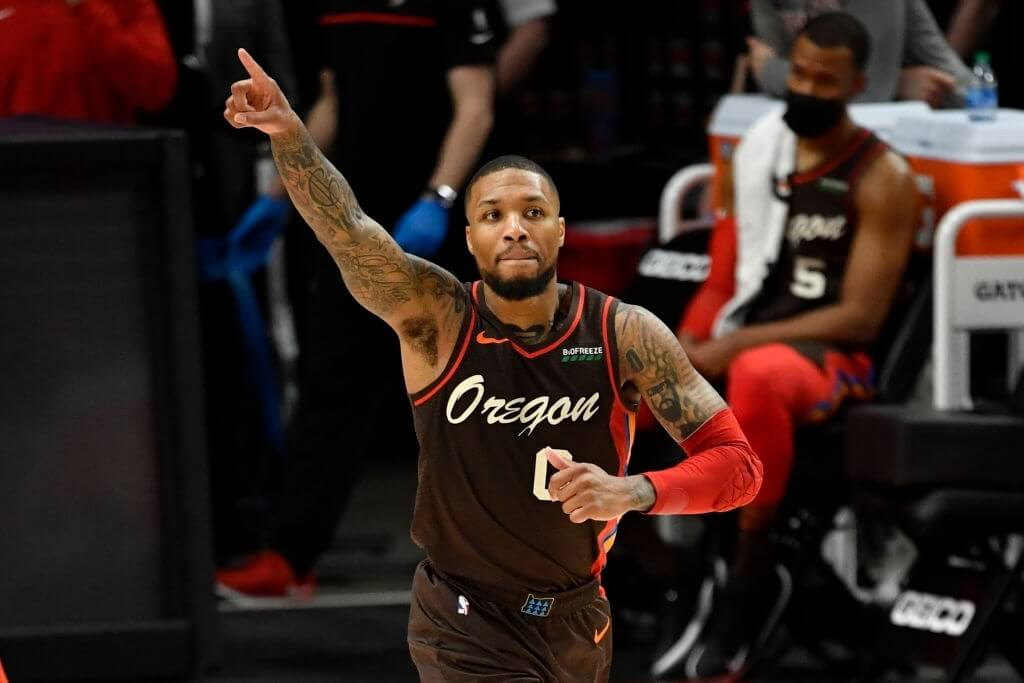 PORTLAND, OREGON - MARCH 21: Damian Lillard #0 of the Portland Trail Blazers points during an NBA game against the Dallas Mavericks at Moda Center on March 21, 2021 in Portland, Oregon. (Photo by Alika Jenner/Getty Images)
