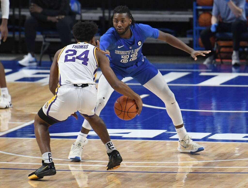 LSU Tigers guard Cam Thomas (240 drives to the basket while defended by Saint Louis Billikens forward Terrence Hargrove, Jr. (22) during a nonconference college basketball game between the LSU Tigers and the Saint Louis Billikens on November 28, 2020, at Chaifetz Arena Arena, St. Louis, Mo.