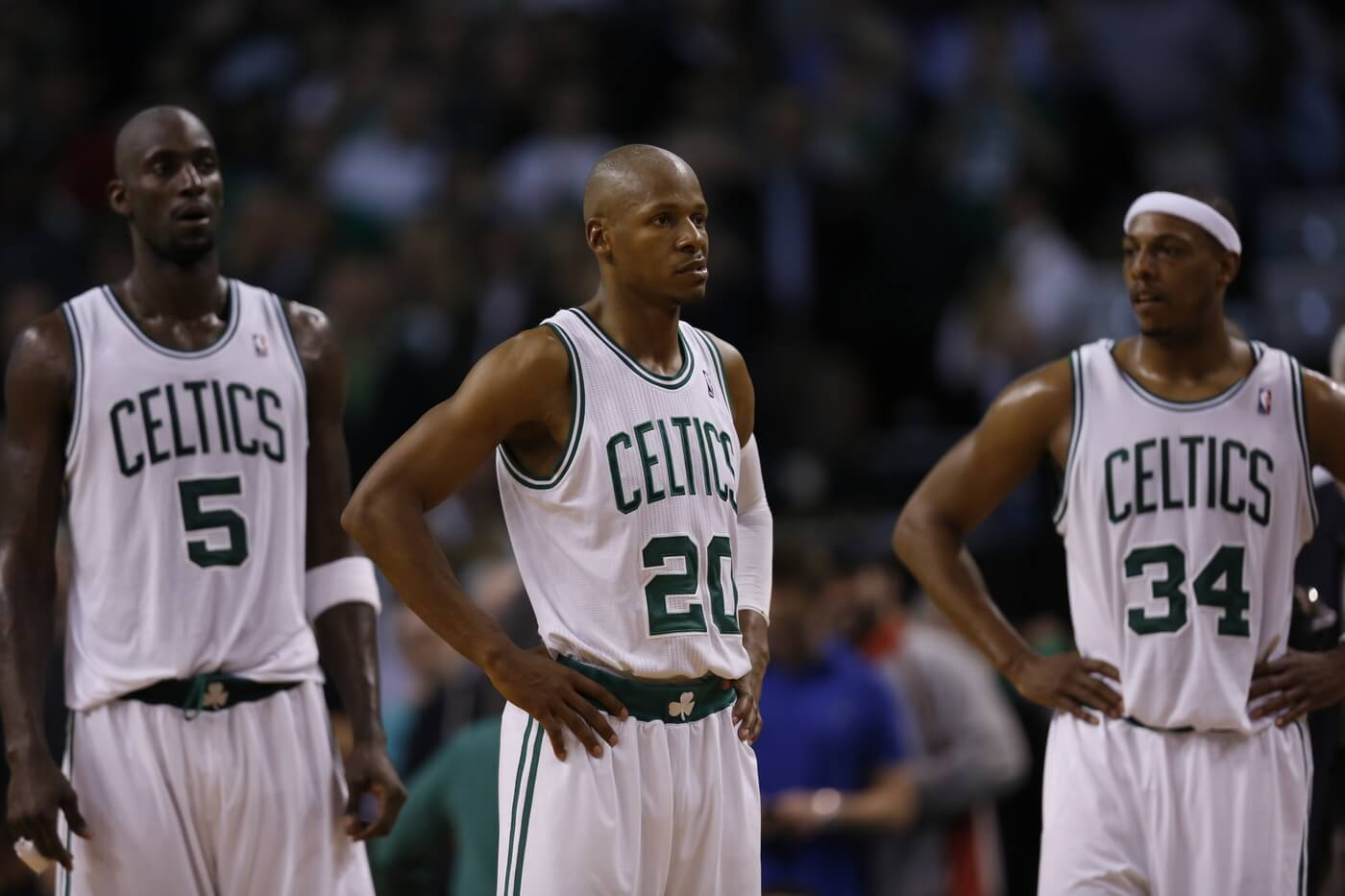 May 14, 2012; Boston, MA, USA; Boston Celtics shooting guard Ray Allen (20), small forward Paul Pierce (34) and power forward Kevin Garnett (5) react as they take on the Philadelphia 76ers during the fourth quarter in game two of the Eastern Conference semifinals of the 2012 NBA Playoffs at TD Garden. The Philadelphia 76ers defeated the Boston Celtics 82-81.