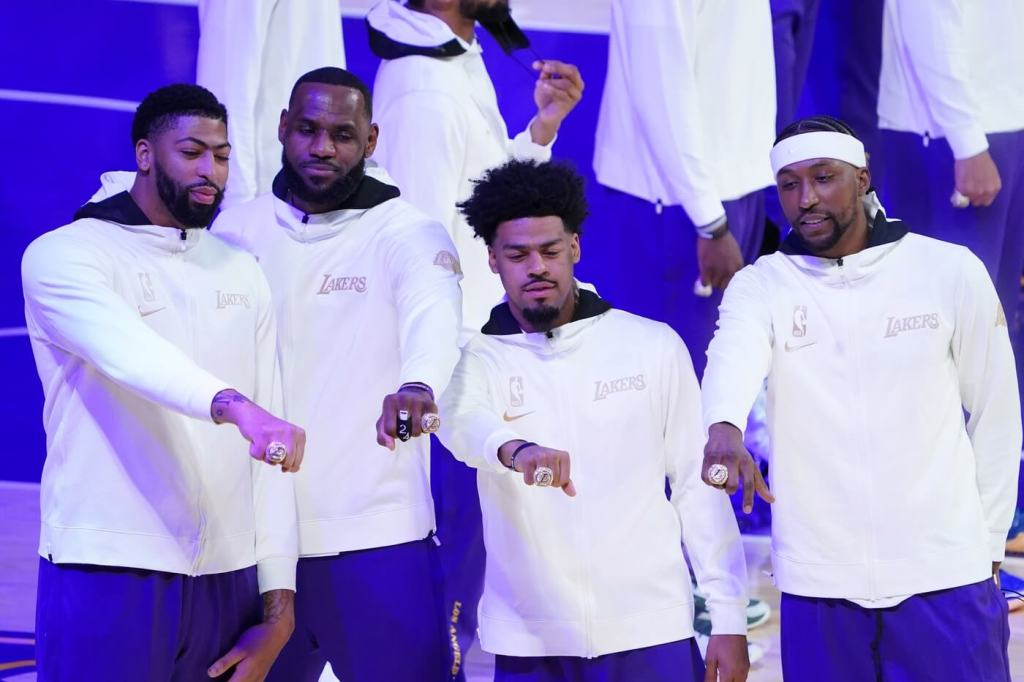 Dec 22, 2020; Los Angeles, California, USA; Los Angeles Lakers players Anthony Davis and LeBron James and Quinn Cook and Kentavious Caldwell-Pope pose with their 2020 NBA Championship rings before a game against the Los Angeles Clippers at Staples Center. Mandatory Credit: Kirby Lee-USA TODAY Sports