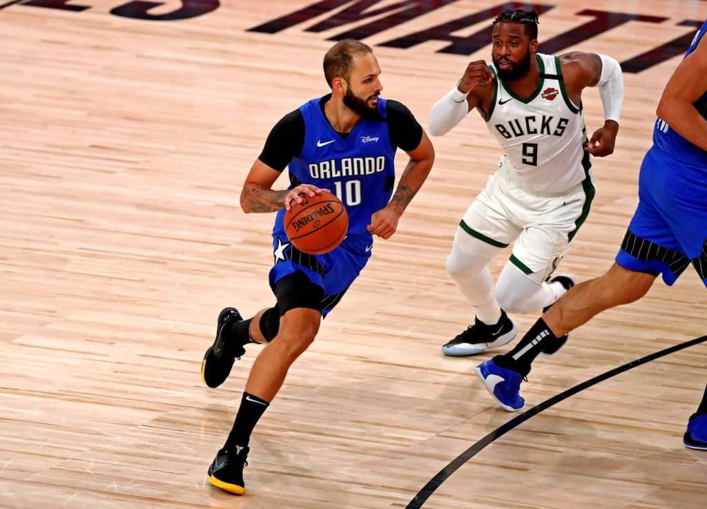 Aug 29, 2020; Lake Buena Vista, Florida, USA; Orlando Magic guard Evan Fournier (10) drives to the basket against Milwaukee Bucks guard Wesley Matthews (9) during the fourth quarter in game five of the first round of the 2020 NBA Playoffs at AdventHealth Arena. Mandatory Credit: Kim Klement-USA TODAY Sports