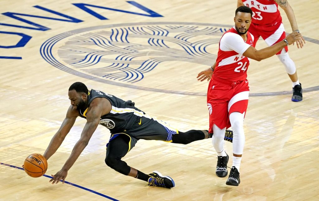Jun 13, 2019; Oakland, CA, USA; Golden State Warriors forward Draymond Green (23) is fouled by Toronto Raptors forward Norman Powell (24) during the fourth quarter in game six of the 2019 NBA Finals at Oracle Arena. Mandatory Credit: Kyle Terada-USA TODAY Sports