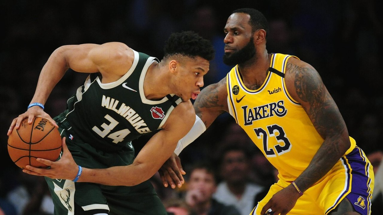 March 6, 2020; Los Angeles, California, USA; Milwaukee Bucks forward Giannis Antetokounmpo (34) controls the ball against Los Angeles Lakers forward LeBron James (23) during the first half at Staples Center. Mandatory Credit: Gary A. Vasquez-USA TODAY Sports