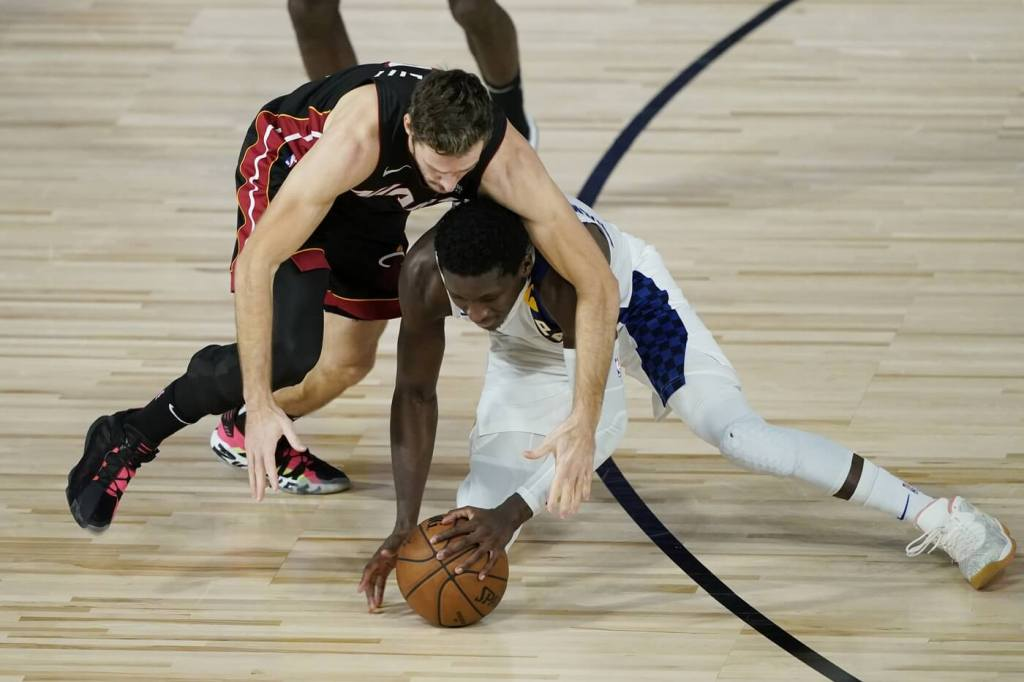 Aug 24, 2020; Lake Buena Vista, Florida, USA; Miami Heat's Goran Dragic, left, and Indiana Pacers' Victor Oladipo scramble for the ball during the second half in game four of the first round of the 2020 NBA Playoffs at The Field House. Mandatory Credit: Ashley Landis/Pool Photo-USA TODAY Sports