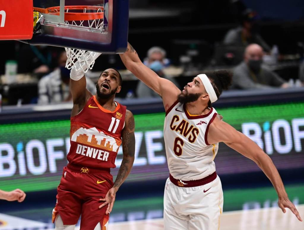 Feb 10, 2021; Denver, Colorado, USA; Cleveland Cavaliers center JaVale McGee (6) blocks the shot of Denver Nuggets guard Monte Morris (11) in the first first quarter at Ball Arena. Mandatory Credit: Ron Chenoy-USA TODAY Sports