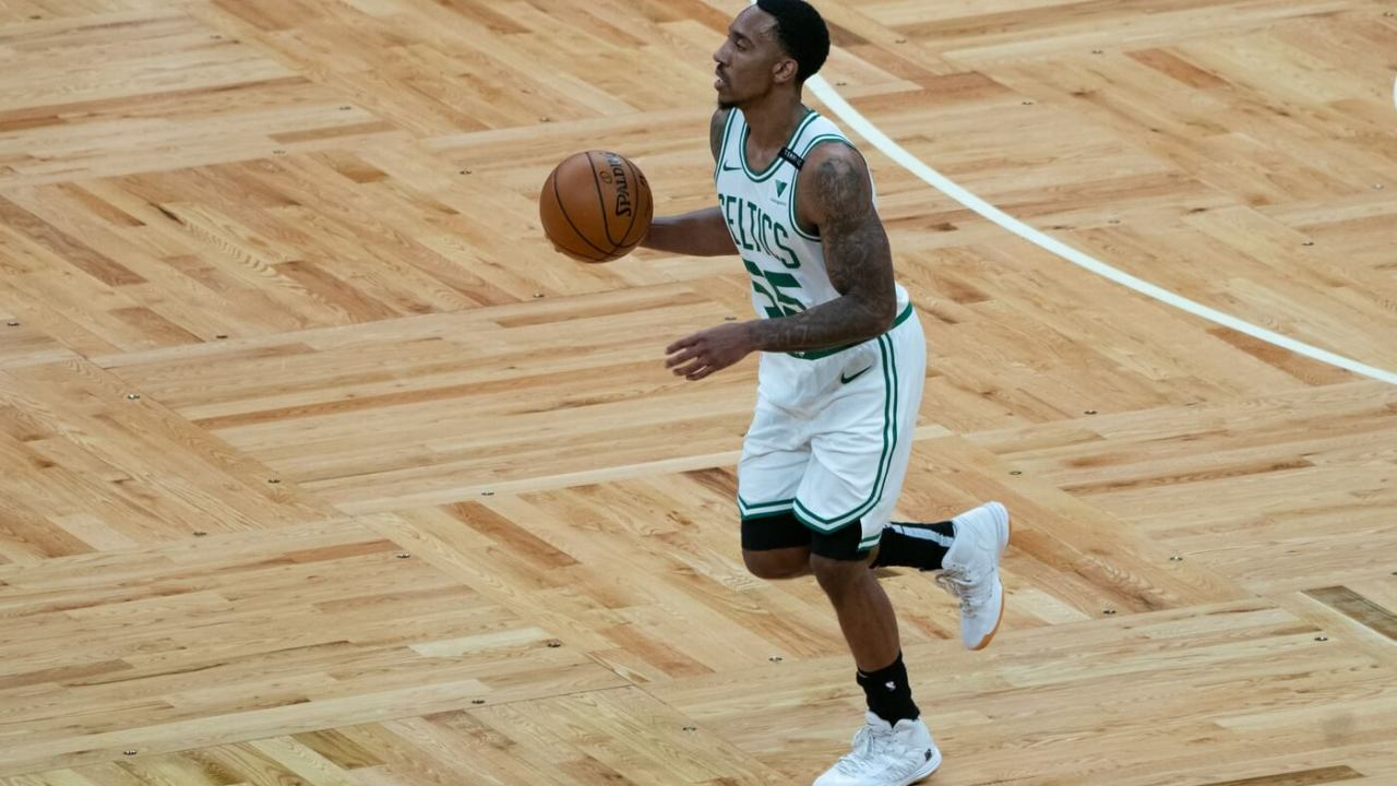 Dec 30, 2020; Boston, Massachusetts, USA; Boston Celtics point guard Jeff Teague (55) dribbles the ball up the court during the third quarter against the Memphis Grizzlies at TD Garden. Mandatory Credit: Gregory Fisher-USA TODAY Sports