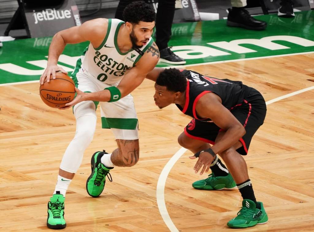 Mar 4, 2021; Boston, Massachusetts, USA; Boston Celtics forward Jayson Tatum (0) works the ball against Toronto Raptors guard Kyle Lowry (7) in the third quarter at TD Garden. Mandatory Credit: David Butler II-USA TODAY Sports