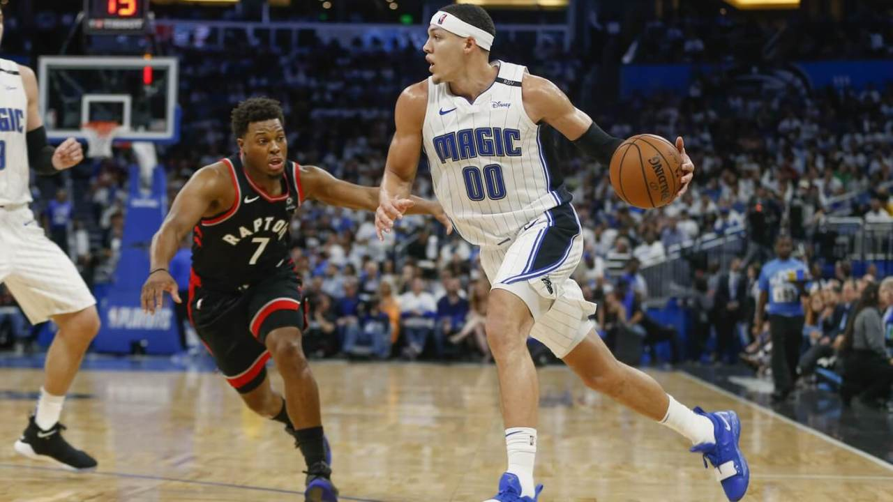 Apr 19, 2019; Orlando, FL, USA; Orlando Magic forward Aaron Gordon (00) drives around Toronto Raptors guard Kyle Lowry (7) during the second half of game three of the first round of the 2019 NBA Playoffs at Amway Center. Mandatory Credit: Reinhold Matay-USA TODAY Sports