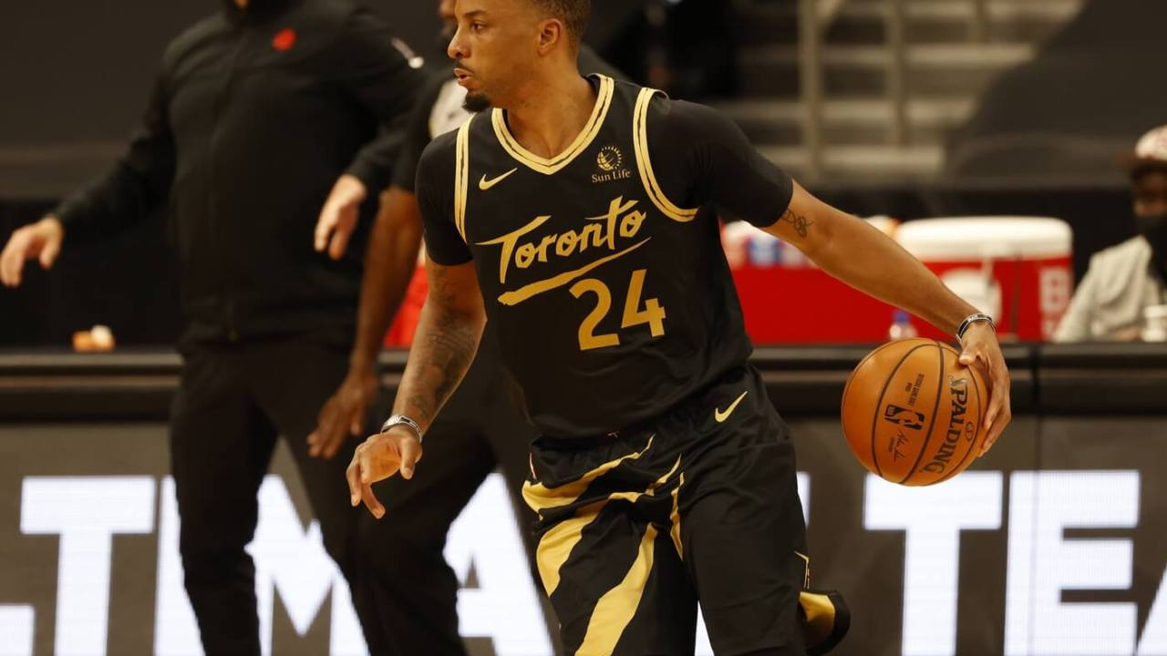 Mar 19, 2021; Tampa, Florida, USA; Toronto Raptors forward Norman Powell (24) drives to the basket against the Utah Jazz during the third quarter at Amalie Arena. Mandatory Credit: Kim Klement-USA TODAY Sports