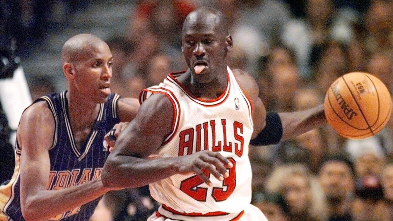 May 31, 1998; Chicago, IL, USA; Chicago Bulls guard Michael Jordan (23), right, is guarded by Indiana Pacers player Reggie Miller (31) in the second half at the United Center. Mandatory Credit: Anne Ryan-USA TODAY